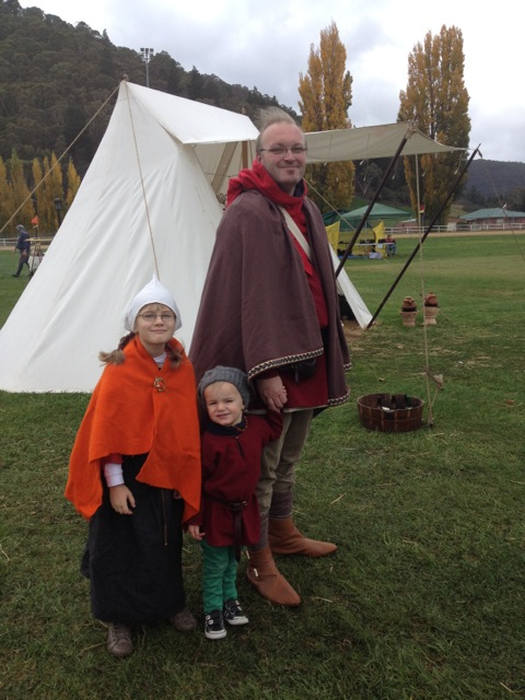 Viking cloaks with raw edges and tablet-woven trim.